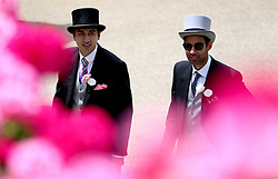 Fashionable racegoers arrive during day five of Royal Ascot at Ascot Racecourse.