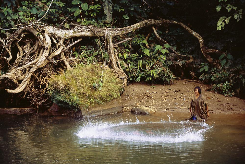 Machiguenga Indian and Cast Net<br />Timpia Community, Lower Urubamba River<br />Amazon Rain Forest, PERU.  South America
