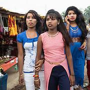 Indian teenage girls walking.