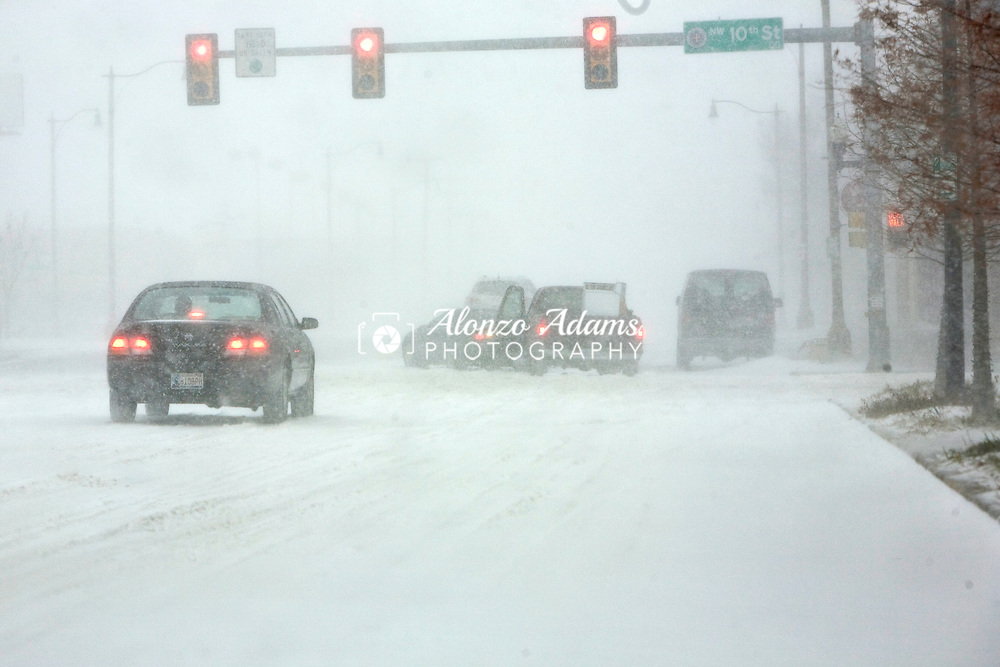 Stuck motorist on Broadway at NW 10th try to help each other during blizzard conditions in downtown Oklahoma City, Okla. at the beginning of the Chrismas Eve 2009 Blizzard.  Oklahoma City ended with a record snowfall of 14.1 inches.
