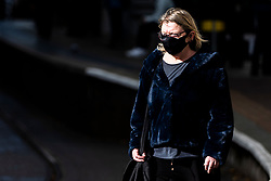 © Licensed to London News Pictures. 20/10/2020. Manchester, UK. A woman wears a mask in central Manchester. Manchester is expecting to be forced in to a Tier 3 lockdown unless a deal is agreed, which could see businesses such as pubs and bars closed. Photo credit: Kerry Elsworth/LNP