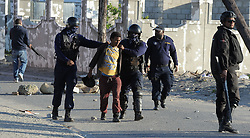South Africa - Cape Town - 28 June 2020 - Protestors arested and Police fire rubber bullets at protestors as a truck was Set alight on Wimbledon Road Blackheath by protestors from the Happy Valley township. Law Enforcement, SAPS had their hands full when hundreds of protestors burnt tyres and threw stones in Happy Valley. Picture: Brendan Magaar/African News Agency(ANA)