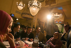 Amr Khaled, an Islamic televangelist, is seen addressing his followers at a Life Makers gathering inside a local wedding hall, Cairo, Egypt, Dec. 23, 2005. Khaled had previously been asked to leave Egypt as his revival gained strength. As a result he started preaching on several television shows, turning him into an international celebrity.