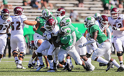 Sep 5, 2020; Huntington, West Virginia, USA; Eastern Kentucky Colonels running back Kyeandre Magloire (4) runs the ball and is stopped by Marshall Thundering Herd defensive lineman Immanuel Bush (59) during the fourth quarter at Joan C. Edwards Stadium. Mandatory Credit: Ben Queen-USA TODAY Sports