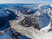 Fly over Tokositna Glacier in Denali National Park and Preserve, Alaska, USA. See a vast wilderness of glaciers, icy peaks, and deep granite gorges in the Alaska Range around Mount McKinley / Denali.