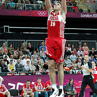 31 July 2012: Russia Victor Khryapa dunks the ball during the 73-54 Russia victory over China, during the men's basketball preliminary, at the Basketball Arena, in London, Great Britain.