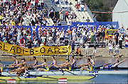 Sydney, AUSTRALIA, GBR M8+Bow Andrew LINDSAY, throws his arms back as the GB crew cross the finishing line to win the Olympic Gold Medal by 0.8/sec, at the 2000 Olympic Regatta, Penrith Lakes. [Photo Peter Spurrier/Intersport Images]  [left to right] LINDSAY, Andrew, HUNT-DAVIS, Ben, DENNIS, Simon, ATTRILL, Louis, GRUBOR, Luka, WEST, Kieran.SCARLETT, Fred, TRAPMORE Steve and cox DOUGLAS, Rowley 2000 Olympic Regatta Sydney International Regatta Centre (SIRC) 2000 Olympic Rowing Regatta00085138.tif