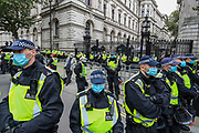 "British police mounted a security line outside Downing Street in central London, on Saturday, Aug 29, 2020 - as anti-lockdown protesters, who believe that the coronavirus pandemic is a hoax, gathered at the 'Unite For Freedom' outside Downing Street. Police officers and members of the press wearing face masks who are monitoring the gathering are often shouted at ""take off the Mask"". (VXP Photo/ Vudi Xhymshiti)"