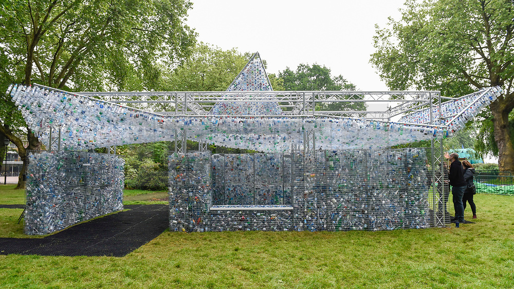 """© Licensed to London News Pictures. 24/05/2018. LONDON, UK. Unveiling of an art installation called """"Space of Waste"""" by architect Nick Wood, in ZSL London Zoo.  The artwork comprises a building made of 15,000 discarded single-use bottles collected from London and its waterways and is part of ZSL's #OneLess campaign, aiming to protect the world's oceans by encouraging people to stop using single-use plastic bottles.  Photo credit: Stephen Chung/LNP"""