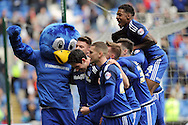 Cardiff City's Peter Whittingham (centre head down) celebrates with his team mates and club mascot Bartley The Bluebird (l) after scoring his teams 2nd goal. Skybet football league championship match, Cardiff city v Bolton Wanderers at the Cardiff city Stadium in Cardiff, South Wales on Saturday 23rd April 2016.<br /> pic by Carl Robertson, Andrew Orchard sports photography.