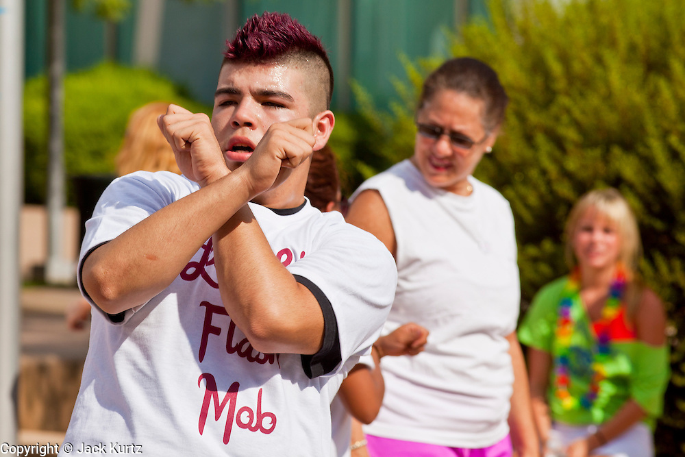 """30 JULY 2011 - PHOENIX, AZ:  NICK VELA, from Phoenix, AZ, dances in a flash mob in Phoenix Saturday. About 200 people showed up at Heritage Square in downtown Phoenix Saturday morning for a flash mob coordinated by the Arizona Science Center. The mob danced to several hip-hop songs before disbanding. The event was a part of National Dance Day Activities and the First Lady's """"Let's Move!"""" physical fitness campaign.        PHOTO BY JACK KURTZ"""