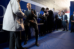President Barack Obama talks backstage with David Simas, Director of the Office of Political Strategy and Outreach, before the Pullman National Monument proclamation signing at Gwendolyn Brooks College Preparatory Academy in Chicago, Ill., Feb. 19, 2015. (Official White House Photo by Pete Souza)<br /> <br /> This official White House photograph is being made available only for publication by news organizations and/or for personal use printing by the subject(s) of the photograph. The photograph may not be manipulated in any way and may not be used in commercial or political materials, advertisements, emails, products, promotions that in any way suggests approval or endorsement of the President, the First Family, or the White House.