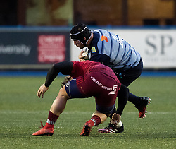 Cardiff Blues' George Earle is tackled by Munster's Chris Cloete<br /> <br /> Photographer Simon King/Replay Images<br /> <br /> Guinness PRO14 Round 15 - Cardiff Blues v Munster - Saturday 17th February 2018 - Cardiff Arms Park - Cardiff<br /> <br /> World Copyright © Replay Images . All rights reserved. info@replayimages.co.uk - http://replayimages.co.uk