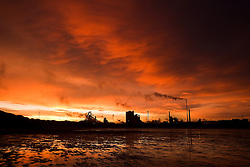 © Licensed to London News Pictures. <br /> 07/01/2015. <br /> <br /> South Gare, Teesside<br /> <br /> A beautiful morning light spreads out over the steel works at South Gare at Teesside and reflects off the wet sand at low tide.<br /> <br /> Photo credit : Ian Forsyth/LNP