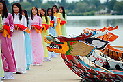 SHOT 7/28/2007 - Women hold blankets that covered the heads of the Dragon Boats prior to the Dotting of the Eyes ceremony at the 2007 Colorado Dragon Boat Festival in Denver, Co. Dragon Boats are awakened, or given life, during the traditional Dotting of the Eyes ceremony which used to involve the eye being painted with the blood of a bird. The sport of Dragon boat racing is over 2000 years old and features teams of 18 paddlers - nine men and nine women plus someone to steer the boat all rowing to the beat of a drum and racing to a flag either 200 or 300 meters away on Sloan's Lake in Denver, Co. Founded in 2001 to celebrate Denver?s rich Asian Pacific American culture, the Colorado Dragon Boat Festival has become the region?s fastest growing and most acclaimed new festival. Festival-goers get to explore the Asian culture through demonstrations, crafts, shopping, eating, and the growing sport of dragon boat racing. .(Photo by Marc Piscotty / © 2007)