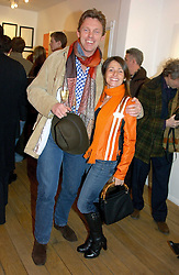 MR TIM HADCOCK-MACKAY Chairman of Grand Heritage Hotels and MILENA ADAMSON at a private view of artist Natasha Law's work entitled 'Hold' held at Eleven, 11 Eccleston Street, London SW1 on 12th January 2006.<br />