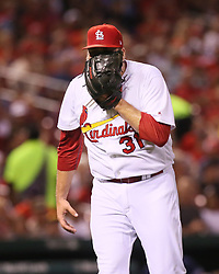 August 22, 2017 - St Louis, MO, USA - St. Louis Cardinals starting pitcher Lance Lynn yells into his glove as he leaves the mound after allowing a three-run double to the San Diego Padres' Yangervis Solarte in the third inning on Tuesday, Aug. 22, 2017, at Busch Stadium in St. Louis. The Padres won, 12-4. (Credit Image: © Chris Lee/TNS via ZUMA Wire)