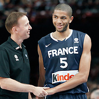 15 July 2012: France head coach Vincent Collet talks to Nicolas Batum during a pre-Olympic exhibition game won 75-70 by Spain over France, at the Palais Omnisports de Paris Bercy, in Paris, France.