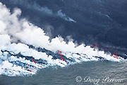 Aerial view of ocean entry zone at Ahalanui where lava from Kilauea Volcano east rift zone erupting from Fissure 8 near the town of Pahoa drains downhill through Kapoho to meet the sea, boiling the sea water and releasing clouds of acidic steam known as laze, Puna District, Hawaii Island ( the Big Island ), Hawaiian Islands, U.S.A.