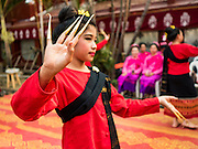 "03 APRIL 2016 - CHIANG MAI, THAILAND: Thai girls perform a traditional northern Thai dance at the dedication of the ubosot, or ordination hall, at Wat Sri Suphan. Wat Sri Suphan is also known as the ""Silver Temple"" because of its silver ubosot, or ordination hall. The temple is more than 500 years old but the silver ordination hall was recently remodeled. The ordination hall is covered in silver and the interior is completely done in silver and gold. It's traditionally served as the main temple for the silversmiths of Chiang Mai, whose community is around the temple.     PHOTO BY JACK KURTZ"