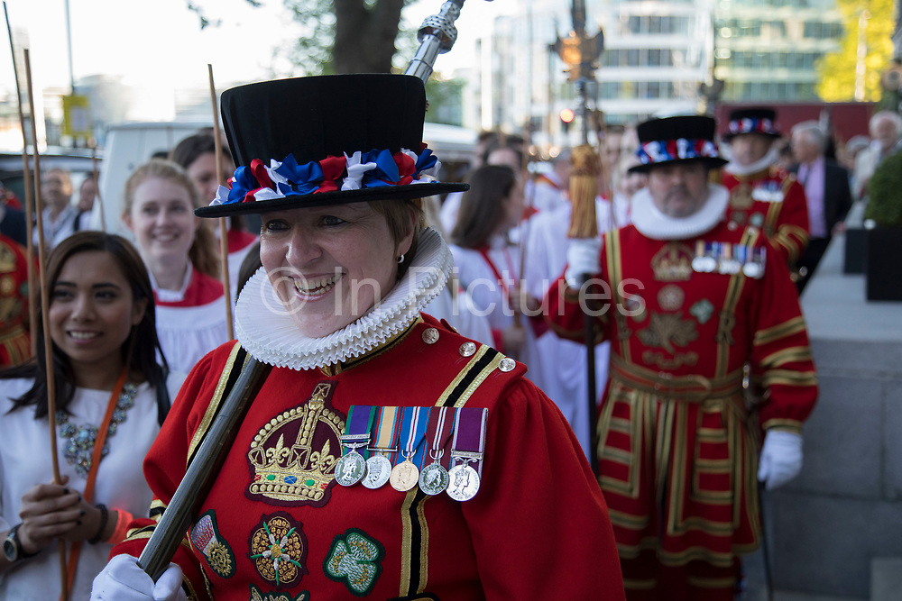 Yeomen Warders also known as Beefeaters from the Tower of London Beating the Bounds on 25th May 2017 in London, United Kingdom. Beating the Bounds is an ancient custom still observed in many English parishes. Its roots go back to mediaeval times when parishes reaffirmed their boundaries by processing round them at Rogationtide, stopping to beat each boundary mark with wands and to pray for protection and blessings for the land. At All Hallows we beat the bounds of our parish every year on Ascension Day. Every third year the ceremony includes a battle with the Governor and Yeomen Warders of HM Tower of London at the boundary mark shared by the Tower and the church. During the middle ages the boundary was always in dispute, and this meeting commemorates an occasion in 1698 when a riot took place between the people of the Tower and those of the parish.