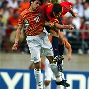 Spain's Fernando Morientes battles with Paraguay's Julio Cesar Caceres