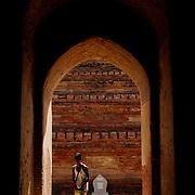 Burmese boy entereing temple at Bagan