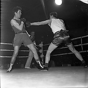 19/01/1962.01/19/1962.19 January 1962.Irish Amateur National Junior Boxing Championships..M. O'Donovan, (right) Mount Talbot Boxing Club Cork, goes full length with a left but fails to land on his opponent J. Codd, Corinthian Boxing Club, Dublin, at the 1st Series Middleweight Contest of the Irish Amateur National Junior Boxing Championships held at the National Boxing Stadium, Dublin. O'Donovan won on points.