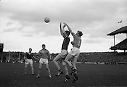19/08/1962<br /> 08/19/1962<br /> 19 August 1962<br /> All Ireland Football Semi Final: Cavan v Roscommon at Croke Park, Dublin. Going for a high ball from a sideline kick are M.B. O'Donohoe, Cavan (centre) and Roscommon's Gerry O'Malley.