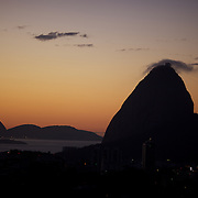 The sun rises behind the summit of Sugar Loaf Mountain, one of the iconic locations with breathtaking views of Rio de Janeiro, Brazil. 26th July 2010. Photo Tim Clayton..