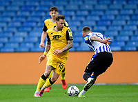 Lincoln City's Chris Maguire vies for possession with Sheffield Wednesday's Jack Hunt<br /> <br /> Photographer Andrew Vaughan/CameraSport<br /> <br /> The EFL Sky Bet League One - Sheffield Wednesday v Lincoln City - Saturday 23rd October 2021 - Hillsborough Stadium - Sheffield<br /> <br /> World Copyright © 2021 CameraSport. All rights reserved. 43 Linden Ave. Countesthorpe. Leicester. England. LE8 5PG - Tel: +44 (0) 116 277 4147 - admin@camerasport.com - www.camerasport.com