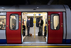 © Licensed to London News Pictures. 18/03/2020. London, UK. Commuters travel on an underground train Baker Street station during the morning rush hour to emptier trains during the Coronavirus outbreak. Photo credit: Ray Tang/LNP