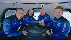 Handout photo dated October 13, 2021 of the crew of NS-18 at apogee. Hollywood actor William Shatner has become the oldest person to go to space as he blasted off aboard the Blue Origin sub-orbital capsule. The 90-year-old, who played Captain James T Kirk in the Star Trek films and TV series, took off from the Texas desert with three other individuals. Mr Shatner's trip on the rocket system - developed by Amazon.com founder Jeff Bezos - lasted about 10 minutes. Photo by Blue Origin via ABACAPRESS.COM