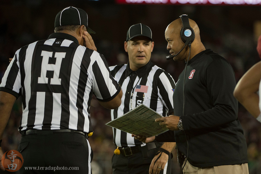 November 14, 2015; Stanford, CA, USA; Stanford Cardinal head coach David Shaw (right) talks to the referees during the first quarter against the Oregon Ducks at Stanford Stadium.