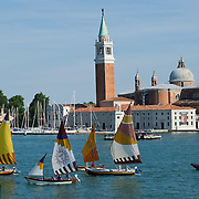 """VENICE, ITALY - JUNE 12:  Few """"vela al terzo"""" boats sail in front of St George Island ahead of the Regatta of the Ancient Maritime Republics on June 12, 2011 in Venice, Italy. The idea of the Regatta of the Ancient Maritime Republics was realized in 1955 and the first edition took place in Genova."""
