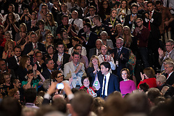 © Licensed to London News Pictures . 23/09/2014 . Manchester , UK . ED MILIBAND and his wife Justine Thornton leave the hall hand in hand after the Leader's speech to the conference . The Labour Party Conference 2014 . Photo credit : Joel Goodman/LNP
