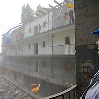 Former illegal residents are hired to demolish the flats they have lived in before the district started reconstruction of the surrounding area called the Dzsumbuj.