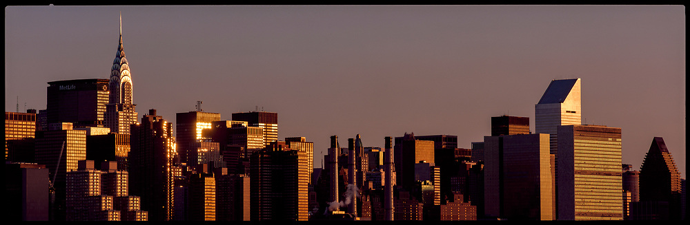 Chrysler and Citicorp buildings with skyline at sunset, New York City, New York, USA, May 1998