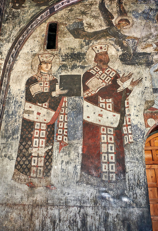 Picture & image of Vardzia medieval cave Church of the Dormition interior secco paintings of Queen Tamar & Giorgi III, part of the cave city and monastery of Vardzia, Erusheti Mountain, southern Georgia (country)<br /> <br /> Inhabited from the 5th century BC, the first identifiable phase of building took place at  Vardzia in the reign of Giorgi III (1156-1184) to be continued by his successor, Queen Tamar 1186, when the Church of the Dormition was carved out of the rock and decorated with frescoes .<br /> <br /> Visit our MEDIEVAL PHOTO COLLECTIONS for more   photos  to download or buy as prints https://funkystock.photoshelter.com/gallery-collection/Medieval-Middle-Ages-Historic-Places-Arcaeological-Sites-Pictures-Images-of/C0000B5ZA54_WD0s<br /> <br /> Visit our REPUBLIC of GEORGIA HISTORIC PLACES PHOTO COLLECTIONS for more photos to browse, download or buy as wall art prints https://funkystock.photoshelter.com/gallery-collection/Pictures-Images-of-Georgia-Country-Historic-Landmark-Places-Museum-Antiquities/C0000c1oD9eVkh9c