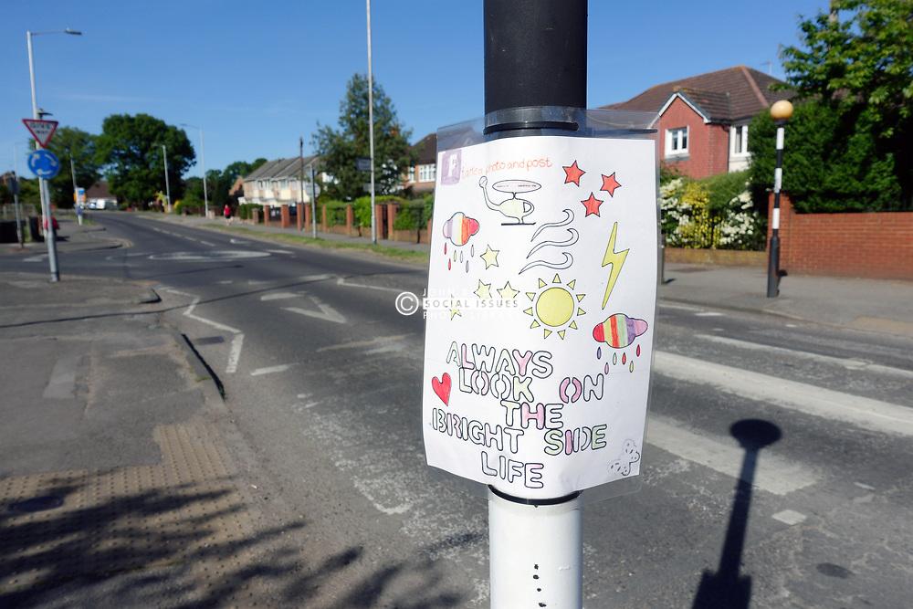 Positive poster on belisha beacon during Mental Awareness Week during Coronavirus lockdown, Reading UK May 2020
