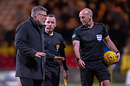 Craig Levein, manager of Heart of Midlothian speaks to referee Bobby Madden after the final whistle the William Hill Scottish Cup quarter final match between Partick Thistle and Heart of Midlothian at Firhill Stadium, Maryhill, Scotland on 4 March 2019.
