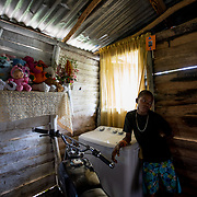 Carlos*, one of seven children in his family, stands in the living room of their vulnerable timber home in the la Cubana area of San Pedro Province in the Dominican Republic, September 12, 2017. The area was not badly hit by Hurricane Irma, though it is prone to diseases, especially now in the rainy season with increased rainfall during the hurricane. Several areas with stagnant water are breeding grounds for mosquitos, increasing cases of dengue, chikungunya, zika and others.