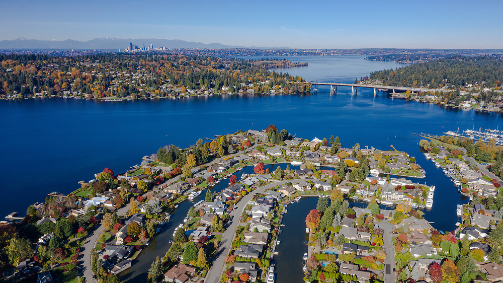 United States, Washington, Bellevue.  Newport Shores neighborhood, Lake Washington and SR520 floating bridge in autumn, with Seattle in distance (aerial view)