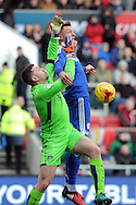 Cardiff City's Anthony Pilkington ® challenges Bristol City goalkeeper Frank Fielding. EFL Skybet championship match, Bristol City v Cardiff City at the Ashton Gate Stadium  in Bristol, Avon on Saturday 14th January 2017.<br /> pic by Carl Robertson, Andrew Orchard sports photography.