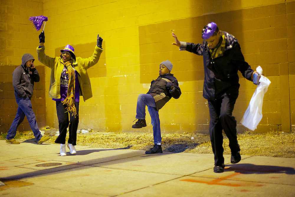 Tyreece Tucker, 11, (center) performs the Ray Lewis dance as Baltimore Ravens fans celebrate the team's Superbowl victory over the San Francisco 49ers in the Fell's Point area of Baltimore, MD on February 3, 2013.  REUTERS/Mark Makela   (UNITED STATES)