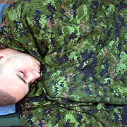 Canadian Cpl. Daniel Nish asleep at combat outpost Ballpeen in the village of Kalache adjacent to the village of Nakhonay, in Panjwa'i District, Kandahar, Afghanistan. In the early months of the summer this outpost was one of the most attacked bases in the Canadian area of operations.<br /> The Canadian Press Images/Louie Palu<br /> CANADIAN SALES AND USE ONLY. NO INTERNATIONAL SALES OR USE.<br /> June 29, 2010