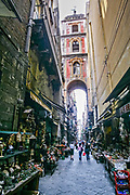 Via San Gregorio Armeno is a street in the historic center with the bell tower of the homonymous church rising above in Naples, southern Italy.