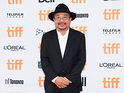 """Rithy Panh poses for photographs on the red carpet for the movie """"First They Killed My Father"""" during the 2017 Toronto International Film Festival in Toronto, ON, Canada, on Monday, September 11, 2017. Photo by Nathan Denette/CP/ABACAPRESS.COM"""