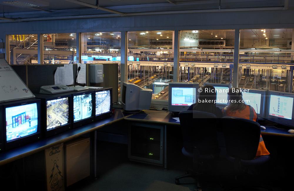 Monitoring logistics by PC at Sainsbury's 700,000 sq ft distribution warehouse depot at Waltham Point, London