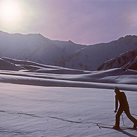 Ski mountaineer Allan Pietrasanta kicks and glides without a pack before descending into the Warwan River Gorge during a pioneering two-week ski expedition from Ladakh to Kashmir, across India's Great Himalaya Range.